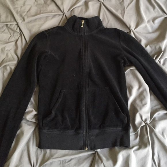 Juicy black zip up Juicy black zip up. Has been sitting in my closet forever and may need a little hand washing has a little spot in the front but can be removed it's reflected in the price. Juicy Couture Sweaters