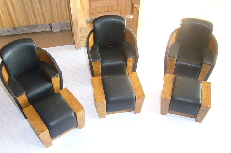 Art Deco or modern chairs with foot rests. Ashwood veneer and black leather. For sale at www.aegminiatures.com