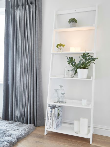 This sturdy, solid Wooden Shelf Ladder has five shelves of varying depths and can be screwed into the wall for extra strength.