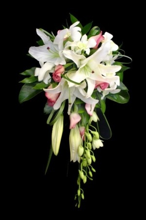 flowers including white lillies, pink roses and white singapore orchids. Amazing scent!