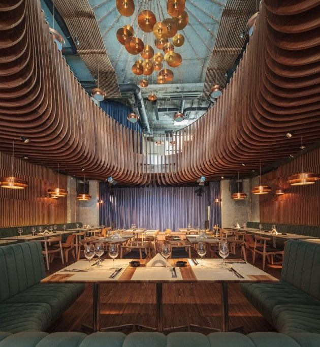 Architect Corvin Cristian has designed the interiors of Studio Hermes, a club and restaurant located in Bucharest, Romania.