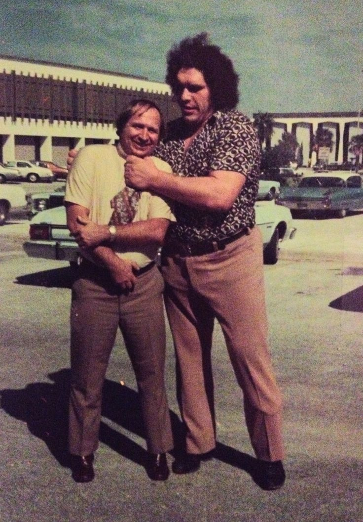 My dad with Andre the Giant in the 70s. Dad says Andre sat inside a car reached out the window and touched the ground.