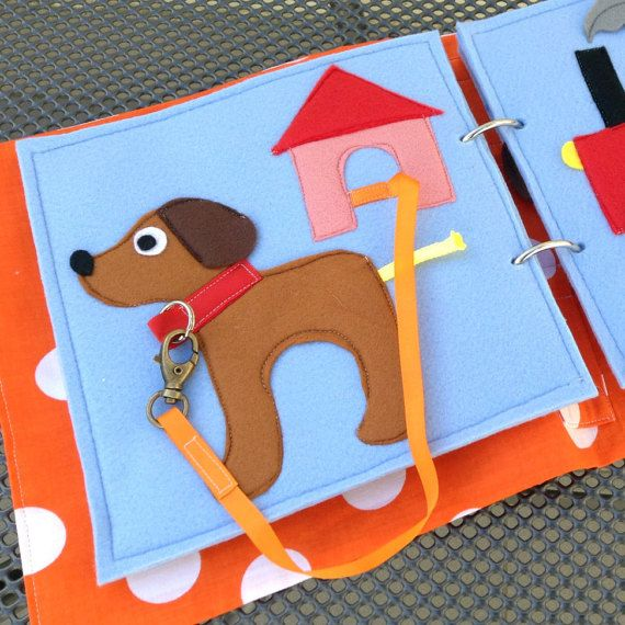 This busy / quiet book page made of felt uses a snap-hook to attach the dogs collar to a leash. Choose any pages from my offer to design the ideal