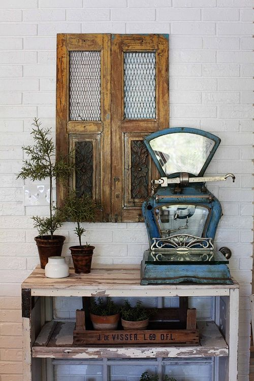 Display with vintage doors and industrial scale.