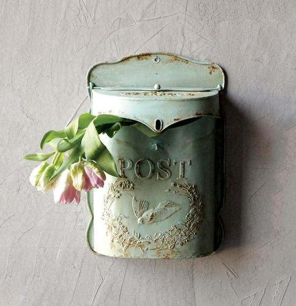 "We love the aqua color of this mailbox. Whether you put your mail in it or use it to display flowers, it's a sweet addition to your decor. Measures 10-1/2""L x 15-1/4""H."