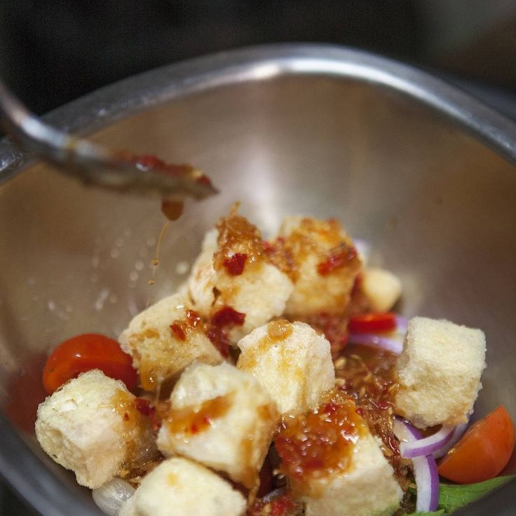 Burmese tofu salad (with chickpeas, vine-ripened cherry tomatoes, sliced red onion, kaffir lime leaves, roasted peanuts.) Dressed in a delicious sticky coconut vinaigrette.