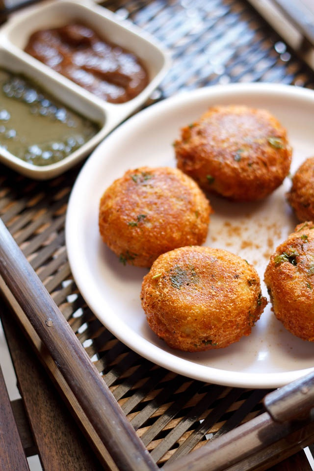 aloo paneer kofta - crisp and melt in the mouth koftas made with potatoes, cottage cheese and stuffed with mix dry fruits.