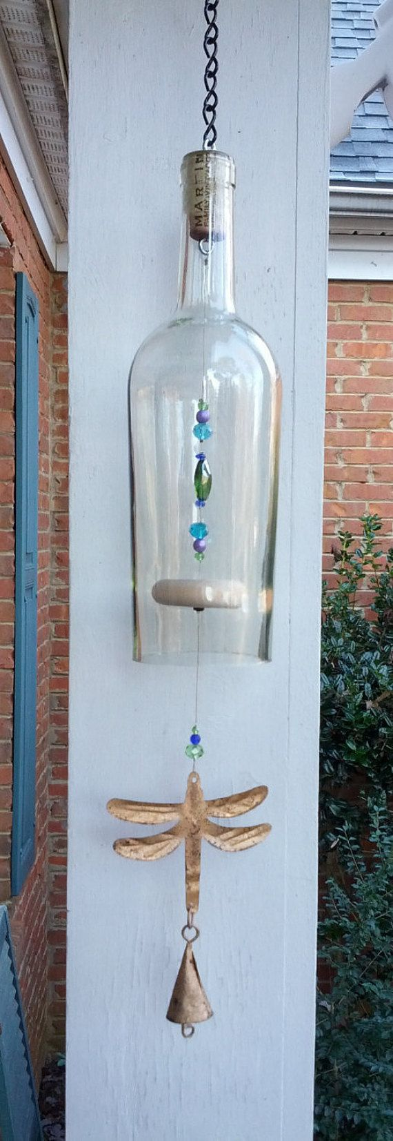 This whimsical wine bottle wind chime is made using glass beads and a wooden dinger strung on a nylon coated steel wire and finished with a