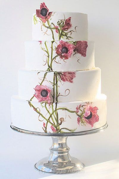 Add extra dimension to your cake by mixing in some 3-D flowers.Cake by Maggie Austin Cake