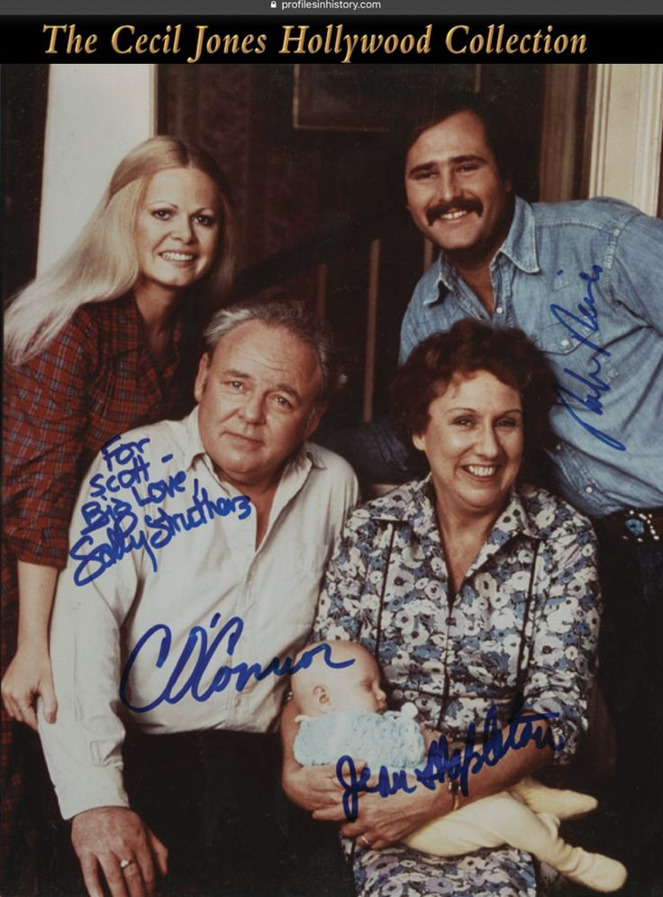"""[All in the Family] Cast signed photograph. (CBS, 1969-1978) 8 x 10 in. color single-weight glossy photograph signed boldly in blue pen by Caroll O'Connor """"Archie Bunker"""", Jean Stapleton """"Edith Bunker"""", Rob Reiner """"Michael Stivic"""" and Sally Strothers """"Gloria Stivik""""."""