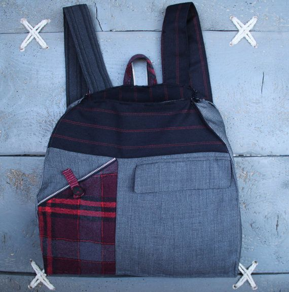 'Eating the goober' handmade backpack made from recycled clothes, (men's suits & shirts) and brand-new textiles Colors: different shades of grey, red, black