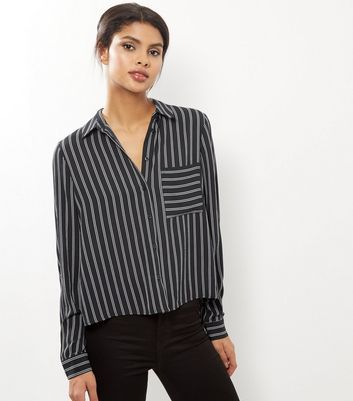 """Bring stripes into your workwear wardrobe this season with this long sleeve shirt. Try teaming with high waisted skinny jeans and block heels to complement.- All over stripe print- Collared neck- Button front fastening- Single pocket front- Simple long sleeves- Casual fit that is true to size- Cropped hem- Marianna is 5'9""""/175cm and wears UK 10/EU 38/US 6"""