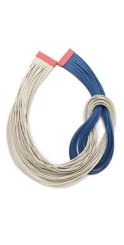 Lanno  Ana Maria Necklace  This handmade necklace features twisted waxed cords. Magnetic closure at leather-bound ends.