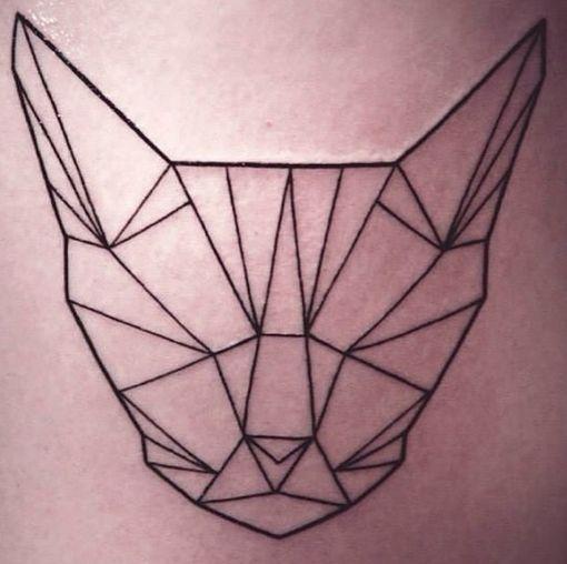 geometric cat tattoo, nearly perfect back thigh