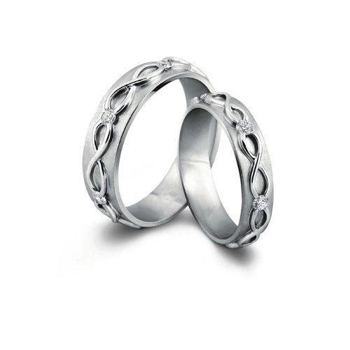 Обручальные кольца Бесконечность с бриллиантами