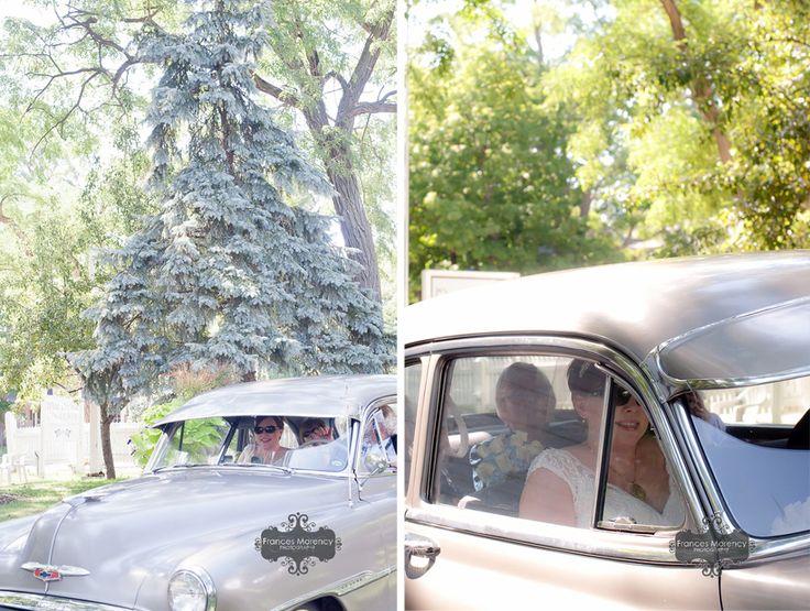 bride arrives in vintage car at the chapel