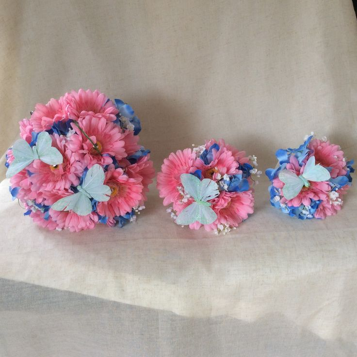Pink and blue bridal bouquets with butterflies by Cathey's flowers