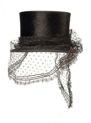 Riding top hat: 19th century -- Riding top hat. Beaver felt riding hat w/ a lace veil, dated c. 1864. This hat was retailed by W.C. Taylor, 1863 -1865 -- © Museum of London