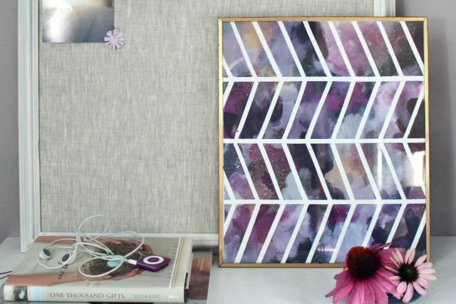 Create your own chevron patterned wall art with masking tape and paint on a canvas.