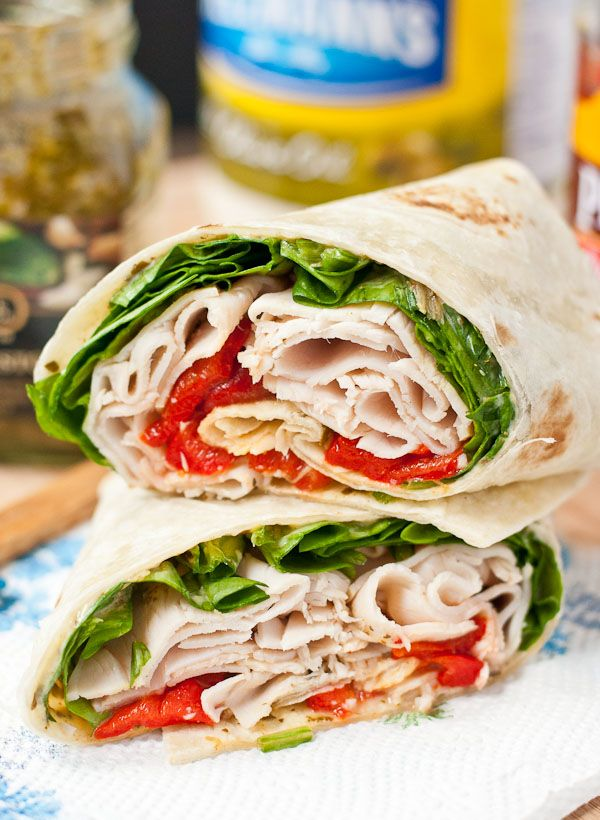 This Spinach, Roasted Red Pepper, and Feta Turkey Wrap will get you out of your sandwich rut!