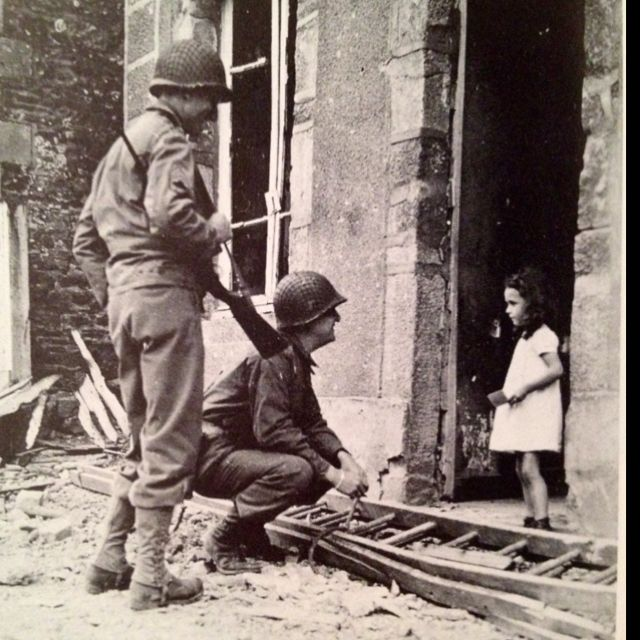 US soldiers talking to the only French girl left in Cerisy-la-salle, France…