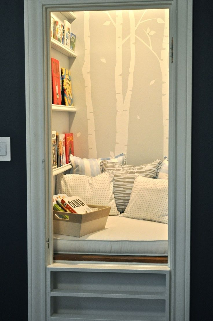 closet turned into a reading corner for kids with pills and book shelf