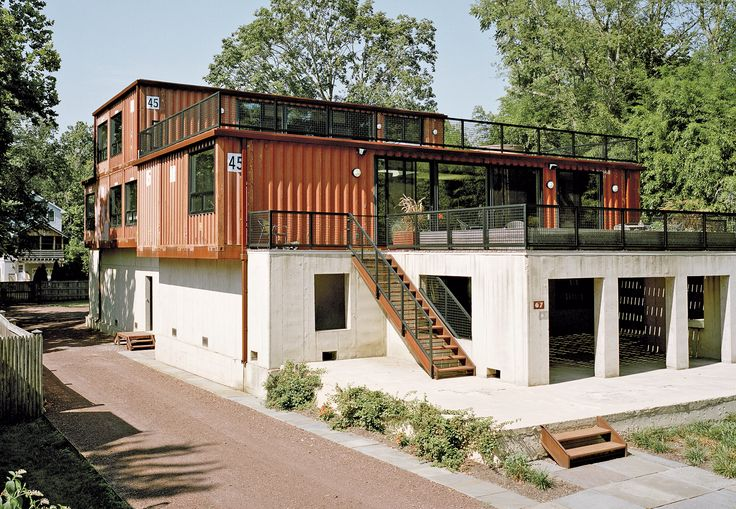 A couple builds a new home, repurposing a series of 11 shipping containers and an existing concrete foundation to maximal effect.