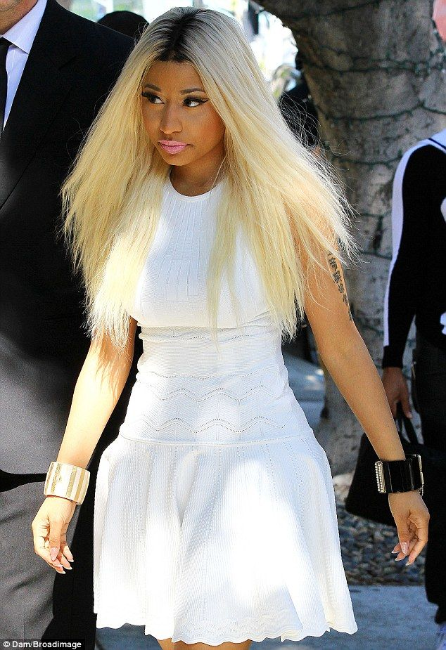 Unexpected: Nicki Minaj wore an elegantly-tame white dress to the MAC store in Beverly Hills, on Friday