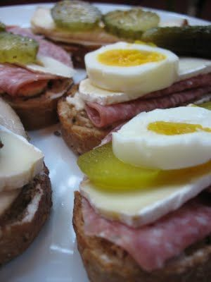 German Sandwiches:Smoked meats or salamis atop fresh seeded breads or crusty rolls with a slice of Brie, hard-cooked egg, and a pickle or cucumber