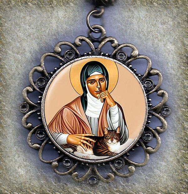 """St. Gertrude pets a cat in this necklace by Etsy artist <a href=""""http://www.etsy.com/listing/123498858/saint-gertrude-of-nivelles-patron-saint?ref=market"""" target=""""blank"""">MarysPrayers</a>."""
