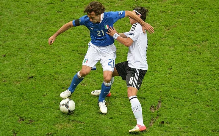 Majestic: once again Andrea Pirlo bosses the midfield. Mesut Ozil tries to disposess him here