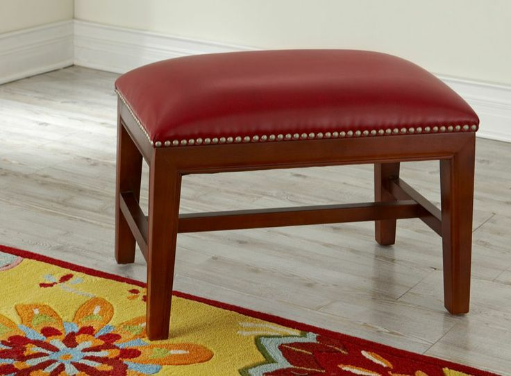 the architectural wood frame of the harriet leather ottoman creates the perfect counterpoint to its smooth