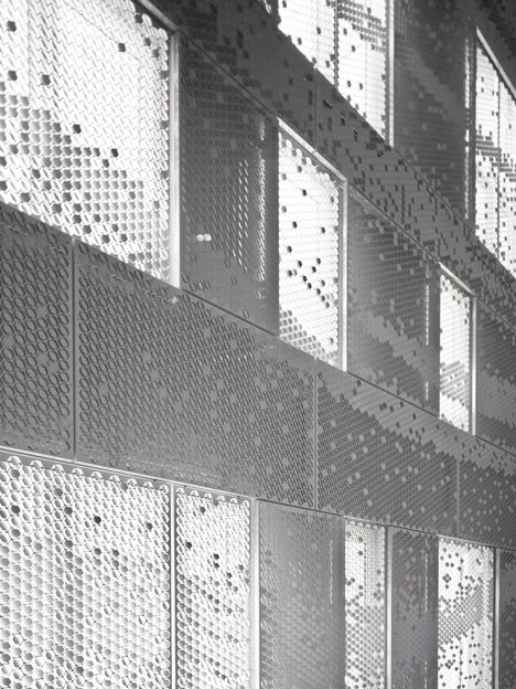 Dutch designer Chris Kabel was approached byarchitecture studioAbbink X de Haas to wrap this house and studio in Amsterdam with a facade of perforated hexagons that catches the light like a hanging sheet of fabric.
