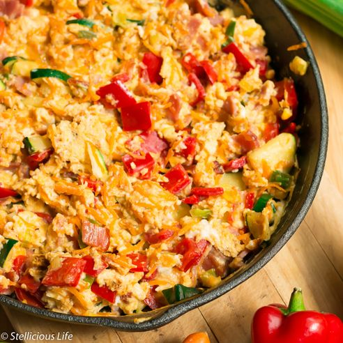 Multicoloured Scrambled Eggs Skillet With Vegetables - For a hearty, filling and protein packed breakfast or brunch eat your scrambled eggs loaded up with plenty of veggies. Not only it looks cheery and colourful but is healthy and delicious as well!