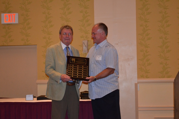 PHPA Executive Director Larry Landon presents long-time PHPA General Counsel, Ron Jaros, with the 2012 Curt Leichner Distinguished Member Award.