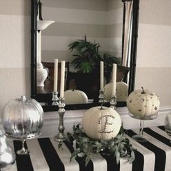Hoilday decor! Love the blk and white stripes but would add bright teal and maybe pink glittered vase or pumpkins