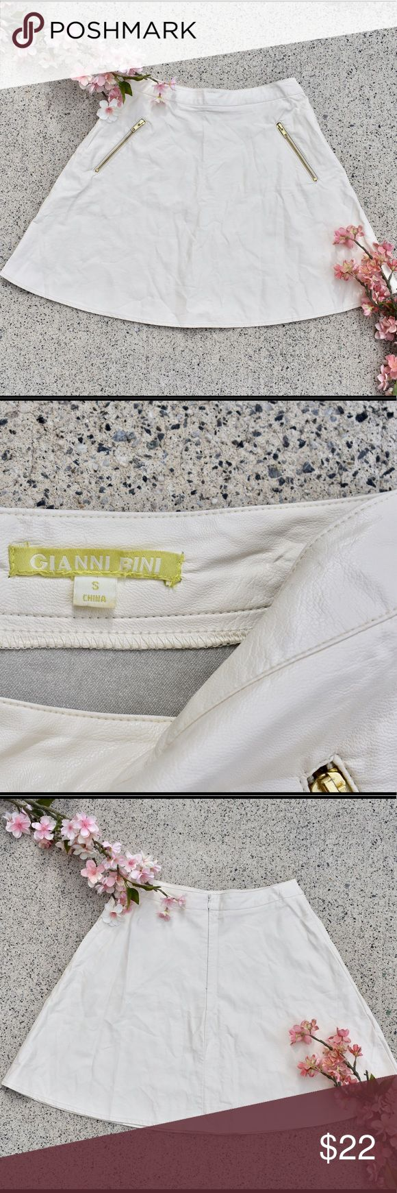 "🌸Faux White Leather Skater Skirt Pre-loved but flawless 💘 the cutest skirt in fabulous white faux leather that screams classy and edgy at the same time! so many ways this skirt could be worn, definitely a must have piece! zips up and has an extra clasp in the back. 17 3/4"" long and 28"" waist. Gianni Bini Skirts"