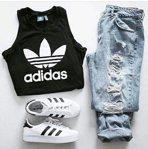 teen girls school outfit with ripped skinny jeans, white crop top,  baby pink sneakers and bomber jacket Image source