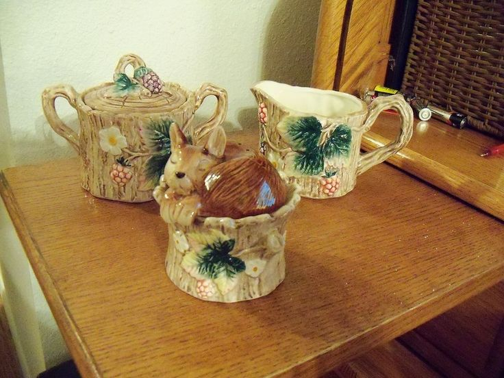 "Reynard Fitz&Floyd ""Tallyho"" 3-pcs.1980. Consists of 3-pcs: creamer, covered sugar, & s&p. Ea. has wooden design w/ leaves, flowers, berries, etc. Sleeping red fox sits atop which forms s&p containers.""Very good - sugar container has 1 very tiny chigger bite -could easily be touched up"" 