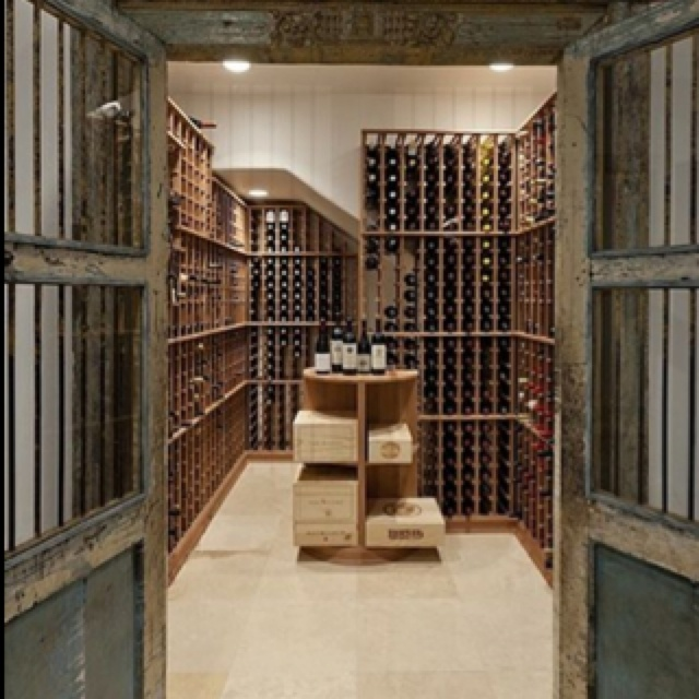 Elegant Vintage Wine Cellar With Wine Crates In The Center