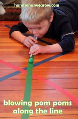 Tape different color tape on floor to create zig-zags. Students can walk the zig-zags or use a straw to blow pom poms along the path
