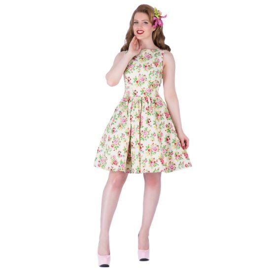 Lady V London Vanilla Sky Floral Tea Retro šaty ve stylu 50. let. Romantický model pro slunečné letní dny - na zahradní oslavy, svatby, večírky pod širým nebem. Vanilkově žlutý podklad s barevnými květy. Příjemný pružný materiál (97% bavlna, 3% elastan), pohodlný střih s lodičkových výstřihem, vzadu lehce vykrojené se zapínáním na zip a vázačkou zajistí skvělé přilnutí k vaší postavě.