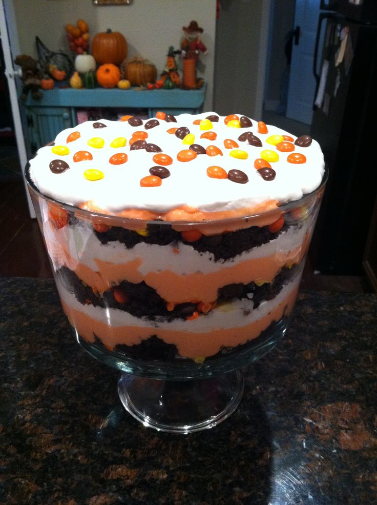 Chocolate cake, vanilla pudding (with orange food coloring), cool whip and Reese's for a festival fall treat!
