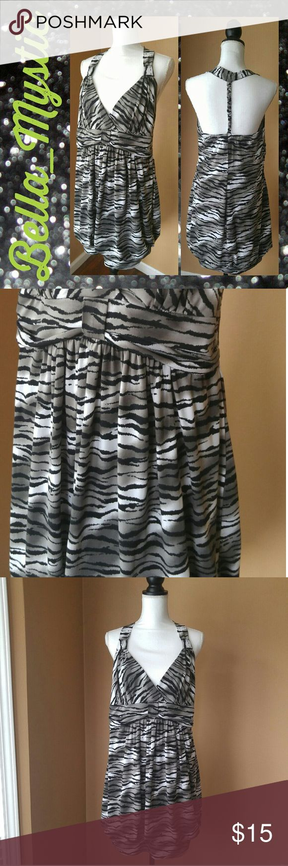 Torrid zebra striped party dress Fun and fearless bold zebra striped dress from torrid.  It features a high empire waist and braided back strap. Its made from stretchy light weight fabric. Gently used no major signs of wear. torrid Dresses Mini