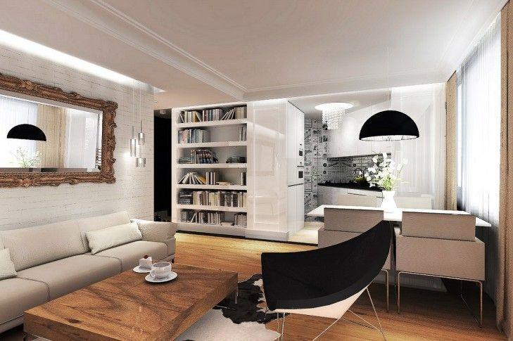 Projekt wnętrz klasycznego salonu z otwarta kuchnią - Tissu. Eleganckie mieszkanie w stylu nowojorskim z biblioteką w salonie i czarno - białą kuchnią. Ciepły odcień podłogi, cegła malowana na biało dodają przytulności wnętrzu. A designerskie dodatki odpowiadają za lekkość i nowoczesność całości. http://www.tissu.com.pl/zdjecia/389,z-nuta-romantyzmu-apartament-piastow-80m2