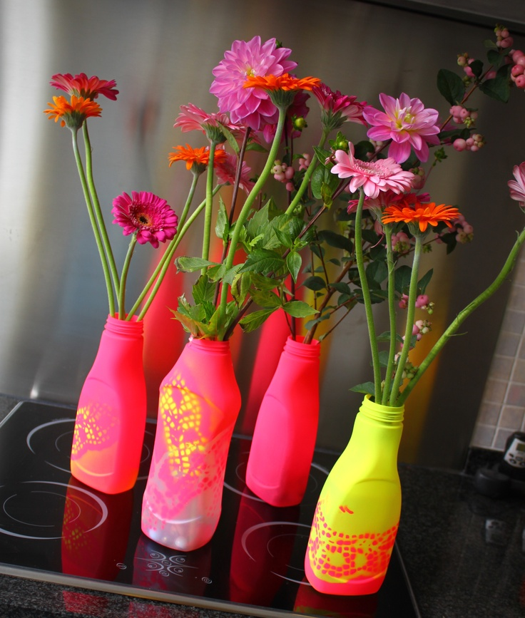 recycled laundry detergent bottles > flower vases > with neon spray-paint