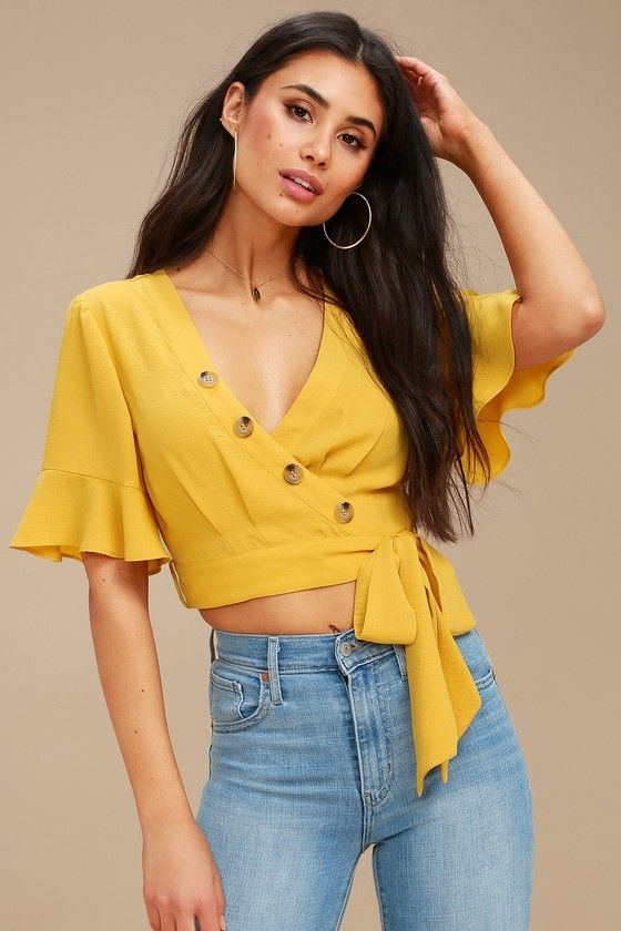 c41aa5c77a5925 From brunch with the ladies to a weekend getaway, the Envie Mustard Yellow  Wrap Crop Top is a perfect fit! Light and gauzy woven fabric sweeps into a  ...