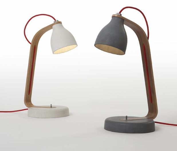 Thin walled cast concrete desk light with walnut/oak arm and aluminium details. benjamin hubert