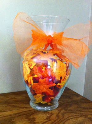 Fall Leaves Vase. Using dollar store items to create beautiful, inexpensive fall decor. From Where the Walunt Trees Grow.