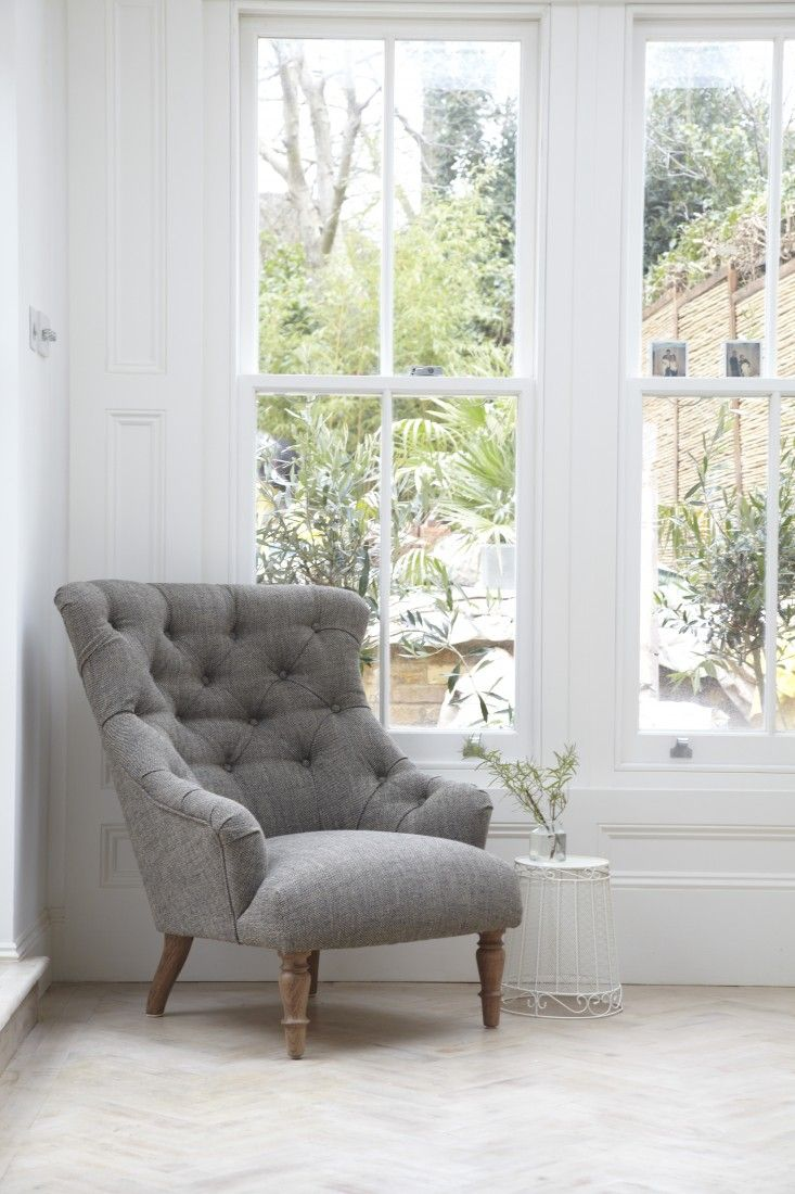 Gray chambray on tufted chair in kitchen designed by @jamieblake